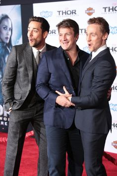 Actors Zachary Levi, Nathan Fillion and Tom Hiddleston arrive at the Los Angeles Premiere 'Thor: The Dark World' on November 4, 2013 at the El Capitan Theatre in Hollywood, California.