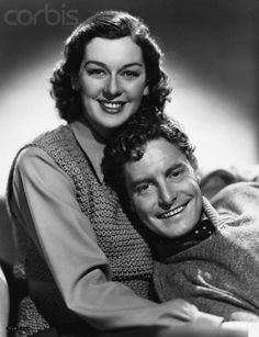 1938 --- Rosalind Russell and Robert Donat --- Image by © John Springer Collection/CORBIS