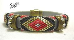 This bracelet is made from faux leather cord with a magnetic clasp, rhinestone studded spacers and 3 strips of beaded peyote stitch (a pattern from