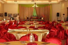 Mehndi Decor Tables with Satin Linen. Gold Table Cloths with Mum Green Runners, Red Chair Covers and Golden Napkins. Tamara & Ali's Wedding.