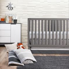 Make matching easy with the Crib Bedding Set Trend Lab Grey. This 3-piece crib bedding set comes with a crib sheet, comforter, and bed skirt – all in a modern grey theme. The coordinating pieces are black, grey and white. The crib sheet is fitted – to fit your standard size crib mattress. Pulling together a nursery has never been so easy.