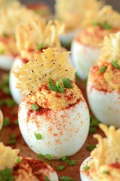 These Deviled Eggs with a Parmesan Crisp are a picture-perfect addition to your table. Sprinkled with paprika and topped with a Parmesan crisp, these homemade deviled eggs are sure to be the prettiest appetizer or side dish at any party. Devilled Eggs Recipe Best, Best Deviled Eggs, Deviled Eggs Recipe, Parmesan Chips, Egg Recipes, Appetizer Recipes, Cooking Recipes, Yummy Appetizers, Recipies