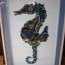 This is Oisin the Seahorse/textile art.  I designed him using small knitted and crocheted wool motifs. He is mounted on a white canvas which I painted with a blue and white acrylic wash.  The finished piece including frame is approximately 3 ft. wide by 4ft long.