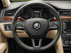 skoda steering wheel superb black multifunction leather interior car badge silver glossy beige dashboard simple sober