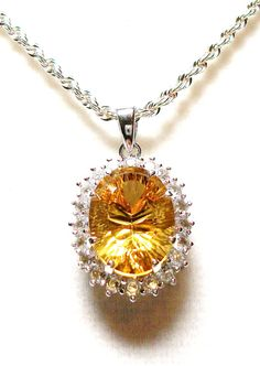 Heliodore accented with white topaz pendant  w/ by Michaelangelas, $219.50  Free worldwide shipping!