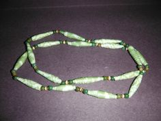 24 1/2 one of a kind paper and glass bead necklace by DandDsJewels, $10.00