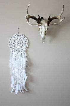 White dreamcatcher with lots of different textured lace and yarns. The beautiful white feathers give it a wintery whimsical look. This dreamcatcher would suit any style decor and would make the perfect gift! READY TO SHIP! Measurements: Hoop: 10 Hanging from hoop: 20 Total: 33