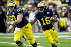 At 6-foot-1, former Michigan center David Molk (50) is one inch taller than quarterback Denard Robinson (16), and smaller than all but six of the 61 centers in the NFL last season.