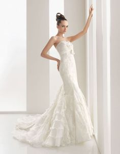 Trumpet/mermaid sleeveless organza floor length bridal gown. I'd love to see it at a different angle, but a cool idea.