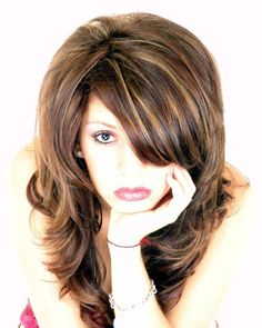 Salon D - Photo Enlargement Very nice carmel highlights with warm brunette.  Love this!....I need a change... Maybe...
