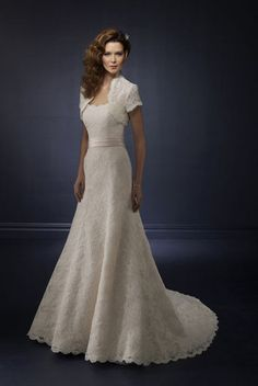 I like the idea of a jacket with the wedding dress. The sash to break up on the lace is nice as well.