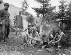 On May 6, 1945, the U.S. 80th Infantry Division liberated the Ebensee Concentration Camp in Ebensee, Austria.  About 60,000 prisoners of 25 different nationalities were liberated, all in various stages of starvation. This photo shows some of the prisoners preparing a meal over an open fire in the camp.