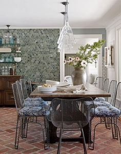 For a burst of color, mimic a tile wall with teal hexagon wallpaper.