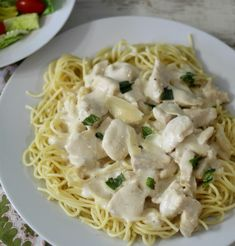 Creamy Chicken Parmesan Pasta - A thick, creamy, cheesy white sauce topped over chicken and pasta.