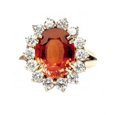Squaw Valley is a fabulous orange garnet and diamond cocktail ring featuring a 6.00ct orange spessartite garnet.  TrumpetandHorn.com // $3,400