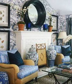 Living Room--blue and white, look at the great use of over-sized decorative elements...the ginger jars and mirror in particular