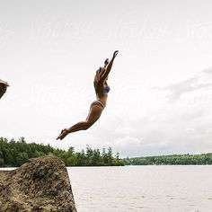 Rise and shine ☀️ #July is here!  This #stockphoto is available on @stocksyunited search: #raymondforbesllc  #jump #lake #cliffjump #water #swim #cannonball #dive #rockjump