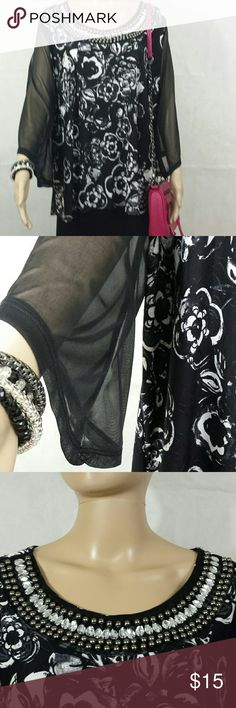"""Top Long Sleeve Dressy long sleeve top. Black and white floral block print patterned flowers. The sheer black sleeves fan out slightly at the wrists.  -faux rhinestone and metal beaded scoop  neckline.  - 24"""" across from underarm to underarm when laid flat -like new -94% polyester, 6% spandex Lavish Plus Tops Blouses"""