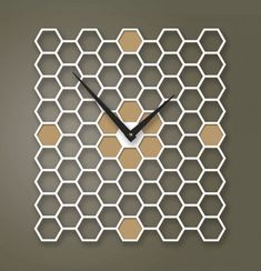 Keith Moore of Pilot Design combines his graphic design background with woodworking skills he acquired to hand-craft colorful modern clocks and lamps.