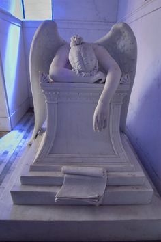 Head side of a blue weeping angel in a crypt of Chapman H. Hyams in Metairie Cemetery. New Orleans, Louisiana.