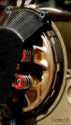 Ducati partial dry clutch cover in carbon fiber.  Note the blue cover bolts.  Stock is a silver color.
