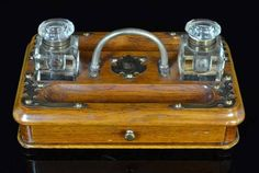 A Victorian oak twin bottle Inkstand, c.1880, decorated with… - Writing - Inkwells & inkstands - Recreations & Pursuits - Carter's Price Guide to Antiques and Collectables