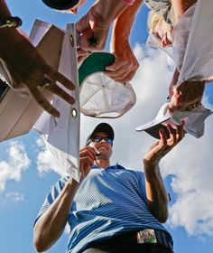 International team player Adam Scott, of Australia, signs autographs for fans following a practice round at the Presidents Cup golf tournament at  Muirfield Village Golf Club