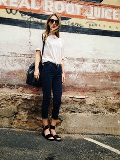 {Street style} | White tee, black belt, high waisted cutoff skinny jeans, black ankle strap sandals, black bucket bag.