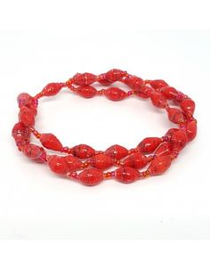Triple Strand Bracelet with small recycled paper beads and red glass seed beads on stretchy string. Red Paper, Strand Bracelet, Paper Beads, Red Glass, Made Goods, Cool Gifts, Seed Beads, Raspberry, Hiv Aids