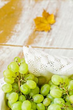 Grapes in basket on wooden table background with some place for text by tanchy on @creativemarket