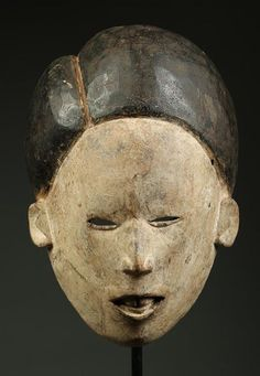 Igbo mask, black and white pigment, 20th century. Private collection.
