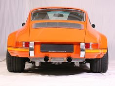 1983 911 SC Coupé one of the best years as I recall. certainly could learn to live w orange. maybe make her the new school bus