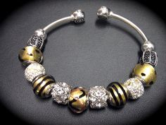 MU inspired Sterling silver Chamilia™ flex bangle bracelet with Swarovski™ crystals and black and gold Murano glass beads. Go Tigers!!