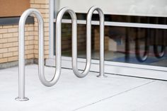 Reliance Foundry's stainless steel MULTI-CURVE bike storage serpentine racks (5 curve) resemble flowing ribbon and provide decorative architectural definition. The model R-8240 can securely store up to 7 bicycles.