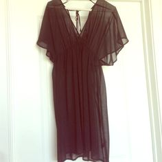 Black Beach Cover Up Sheer cover up great for the beach. Ties in the back. Can fit a medium Forever 21 Dresses