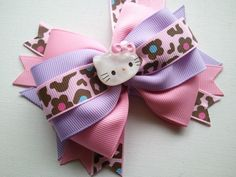 Cute Kawaii, Pink and Leopard Hello Kitty Boutique Hair Bow. $5.95, via Etsy.