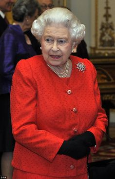 The Queen was dressed in a bright red dress with a matching jacket ...