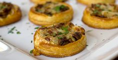 Caramelized Onion, Mushroom and Gruyere Tartlets are baked atop circles of puff pastry for a flaky, savory and delicious appetizer. Carmelized Onions, Puff Pastry Recipes, Appetisers, Galette, Pasta, Finger Foods, Appetizer Recipes, Arrows, Appetizers