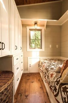 This is the Boxcar Tiny House on Wheels by Timbercraft Tiny Homes out of Guntersville, Alabama. It's a beautiful tiny home with a slanted, shed-style roof. Step inside to the living area, you… Shed To Tiny House, Tiny House Bedroom, Tiny House Cabin, Tiny House Living, Tiny House Plans, Tiny House On Wheels, Small House Living, Tiny House Storage, Small Room Design