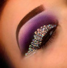 Purple and sparkles eye makeup.