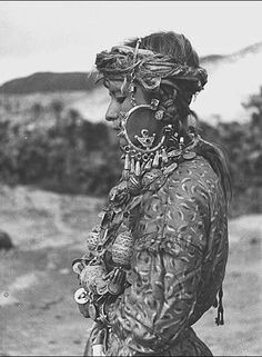 Africa | A Tahla Jewish woman wearing large earrings with seven pendants and the traditional Jewish motive in the center of the pigeon. Morocco. ca. 1935.| © Jean Besancenot
