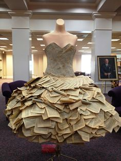 Tiered dress made of pages from romance novels. From Texas Woman's University Women's Collection, on display at the Denton campus library for the summer.