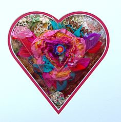 One of my fiber art collages framed in heart shaped mat.