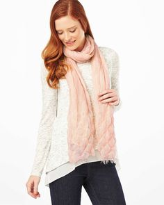 A lightweight scarf with raw hems and a honeycomb finish to the fabric.