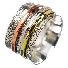 "Solid Sterling Silver, Copper and Bronze Spinner Ring DETAILS: * Size 7 & 8 * 7 g total weight * SOLID .925 Sterling Silver * Stamped .925 * Measures approximately 1/2"" wide Spinner Rings are also cal"