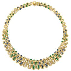 Gold, Emerald, Sapphire and Diamond Necklace, Van Cleef & Arpels.    18 kt., the openwork graduated necklace composed of tiers of twisted gold loops, set throughout in an alternating pattern of 58 round diamonds approximately 5.00 cts., 56 round sapphires approximately 5.75 cts., and 58 round emeralds approximately 4.50 cts.