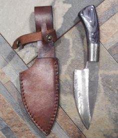 Custom designed handmade utility cooking knife.