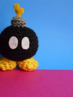 crocheted bob-omb $16    This seller has SO MANY Mario themed crocheted goodies: black and pink bob-ombs, goombas, kirby, boos, mushrooms, invincibility stars, etc, etc, etc.