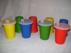Drinking out of these specific multi-colored sippy cups with the soft plastic lids: