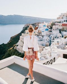 Lace shirt & a print skirt with the most gorgeous Santorini scenery as the backdrop - Anna, Arctic Vanilla blog.